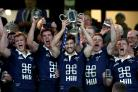 Oxford University captain Dom Waldouck lifts the Varsity Match trophy aloft at Twickenham Picture:  Gareth Fuller/PA Wire