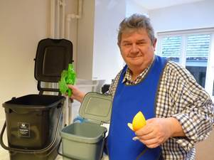 Cabinet member for environment Steve Good with one of the food waste containers Pic: WODC