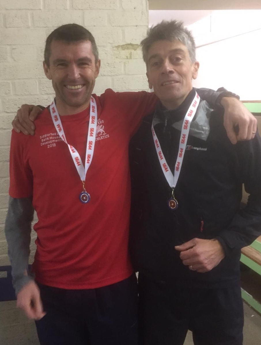 Tegs Jones (left) and Julian Richardson with their medals from the SEAA Masters Cross Country Championships
