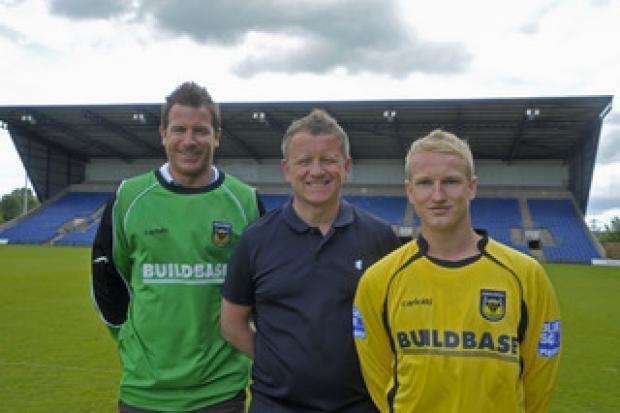 Oxford Mail: New signings Ryan Clarke (left) and Marcus Kelly with manager Chris Wilder