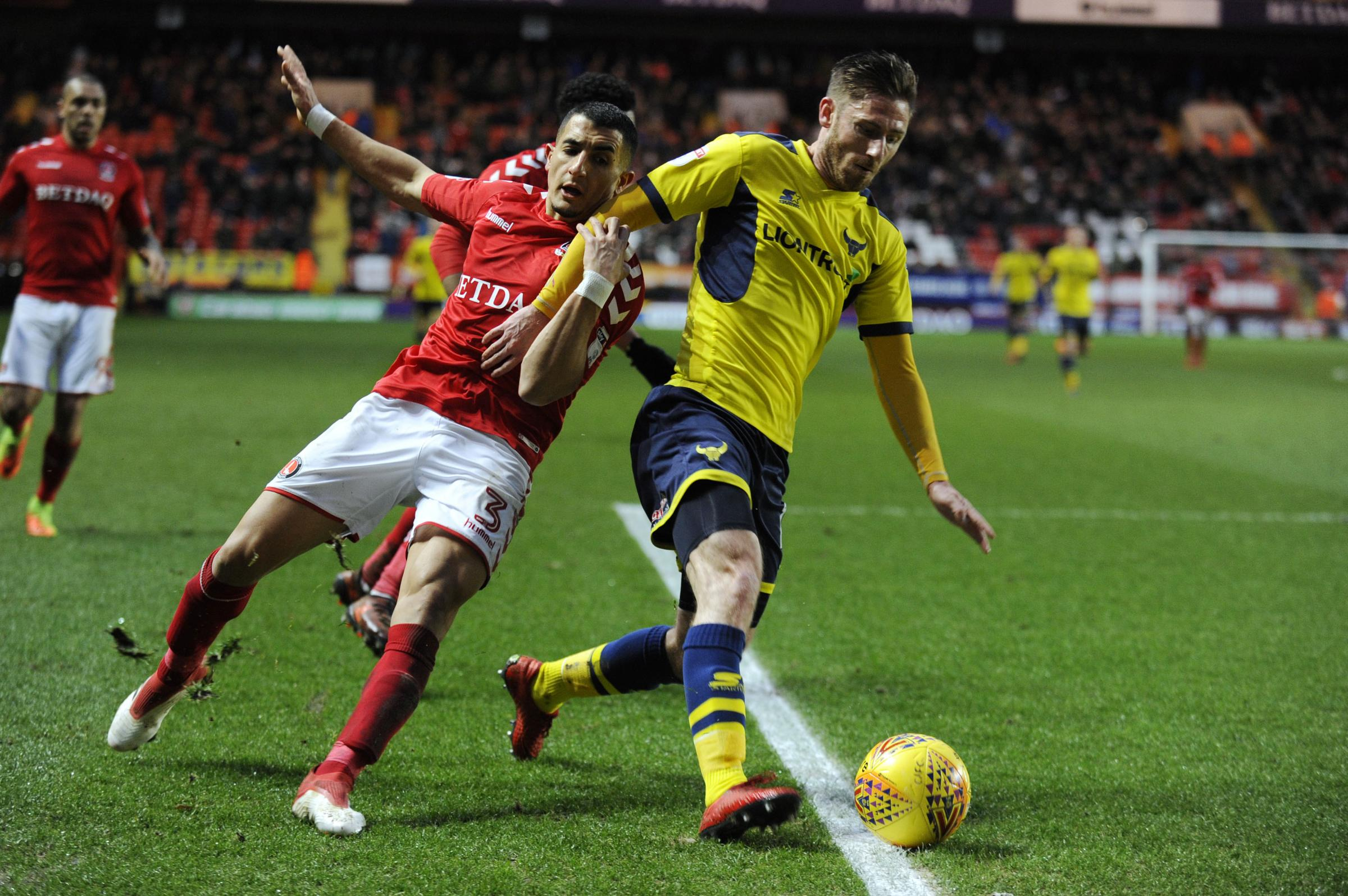 Ahmed Kashi (left) in action against Oxford United for Charlton Athletic last season   Picture: David Fleming
