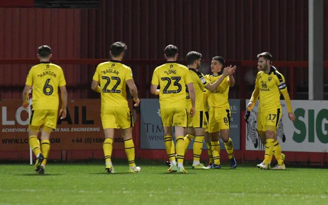 Cameron Brannagan is congratulated after scoring for Oxford United at Cheltenham Town  Picture: David Fleming