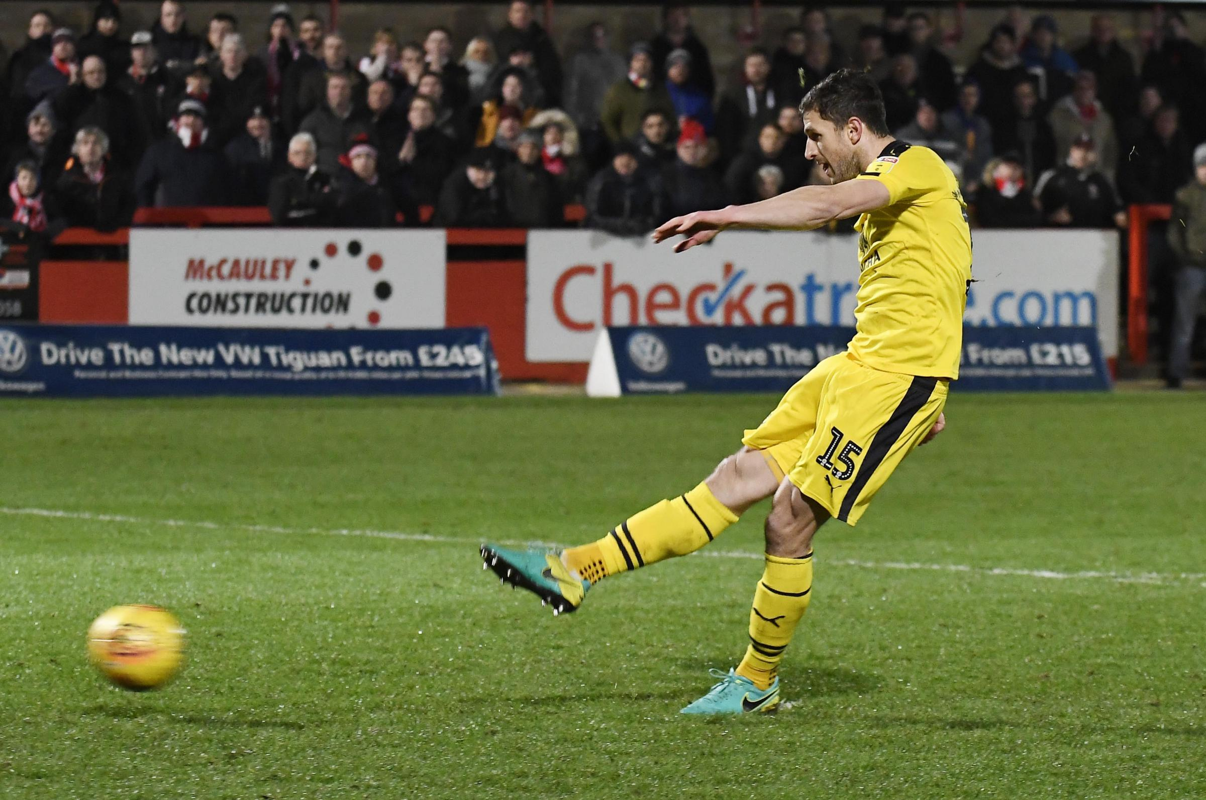 John Mousinho scores his penalty in the shoot-out for Oxford United at Cheltenham Town  Picture: David Fleming