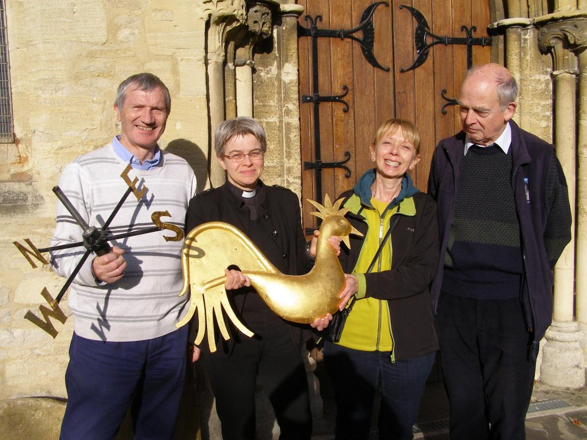 Rev Verena Breed, Rector of Bicester, second left, helping to celebrate the restoration  of the weather vane at St Edburg's Church in 2017