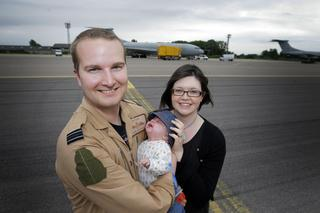Flt Lt Chris Haywood, 27, from Carterton was among those returning, after three-and-a-half weeks away. He was reunited with his wife Melanie, 26, and 10-week-old son Oliver