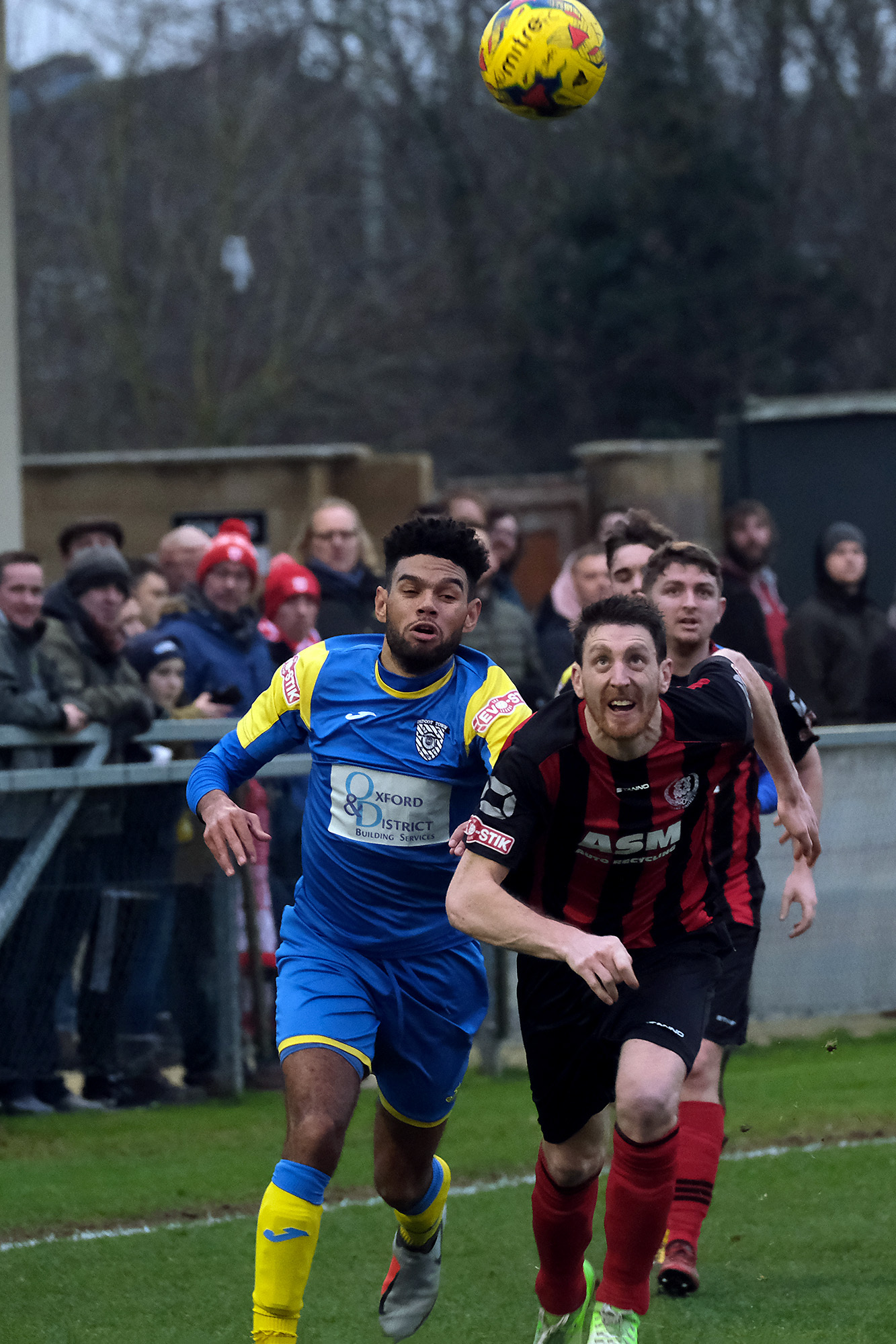 Thame's Andy Gledhill keeps his eyes on the ball as he chases wih Lance Williams during Thame's home 0-1 loss to Didcot .Picture: Ric Mellis.19/1/2019.