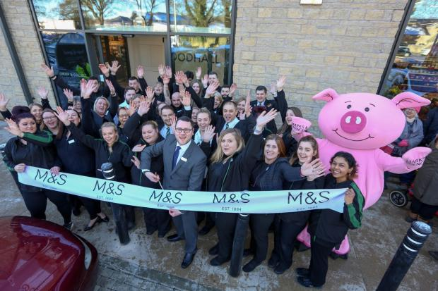 Oxford Mail: Staff celebrate the opening of M&S Foodhall in Chipping Norton. Pic: Anna Lyth