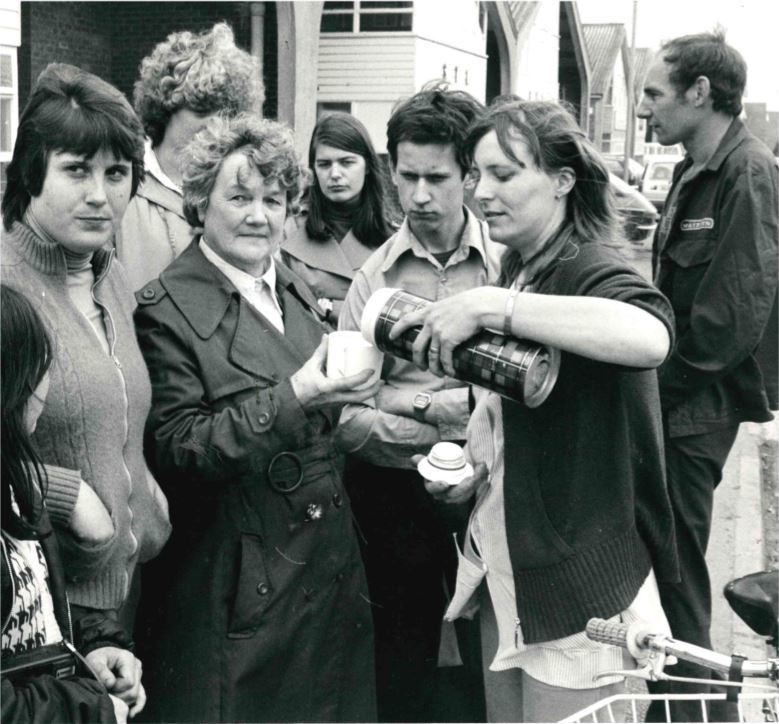Sacked shop steward Mary Aitken pours a cup of coffee for pickets outside the Didcot factory