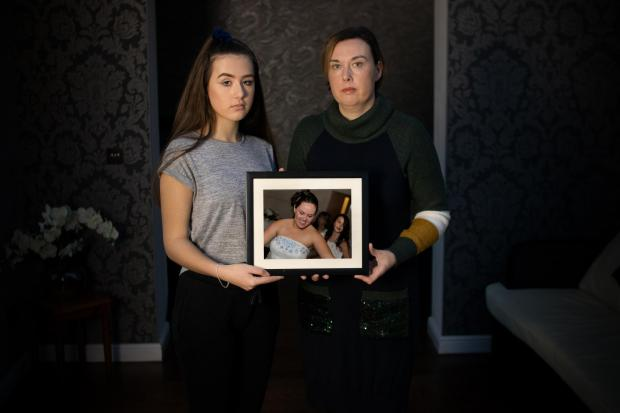 Oxford Mail: Tonight's documentary will also explore the story of Kirstie, pictured with her auntie, Jo. They are holding a photograph of Kirstie's mum, Natalie, who was murdered by an abusive partner. Picture: Behind Closed Doors