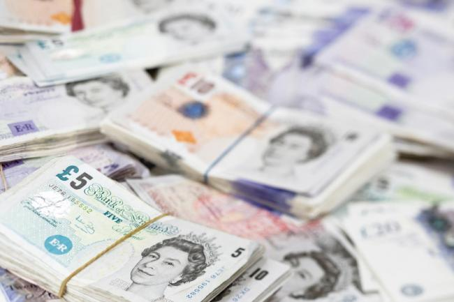Money file photo: a pile of UK cash banknotes