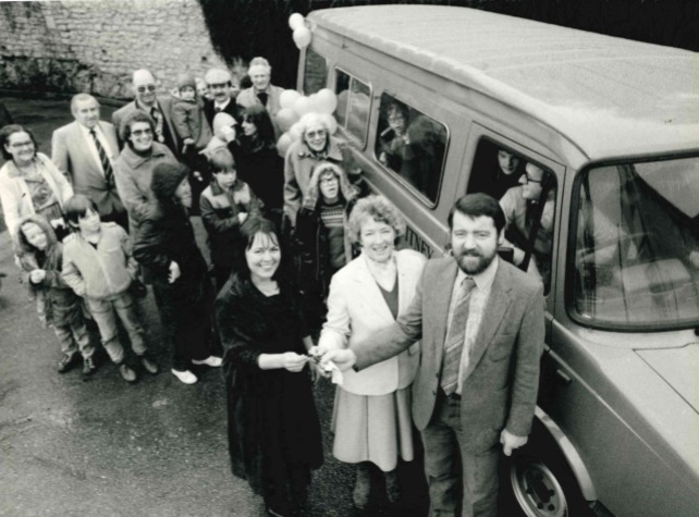 Beryl Lewis (left), head of Springfield School, Witney, receiving keys for minibus from John Ryan and Pat Holborow.  November 29, 1983