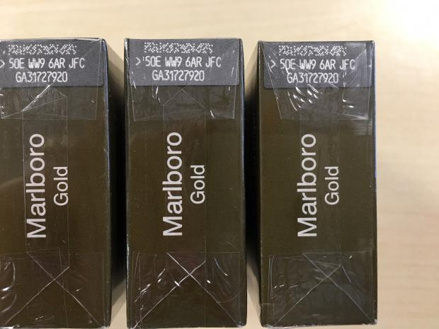 Oxford Mail: These packets of Marlboro Gold cigarettes look like the real thing but each packet should have unique code. If you see the identical code on two or more packets, it's highly likely they are counterfeit.