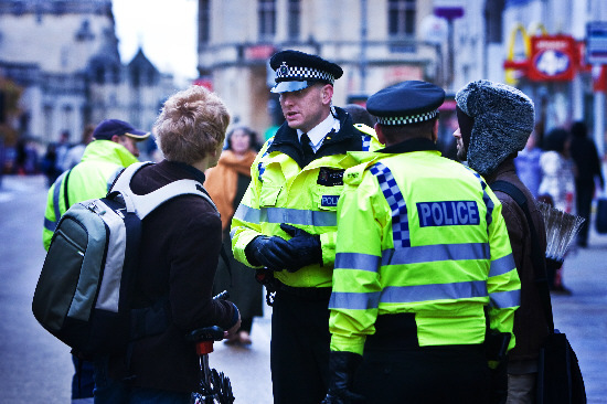 PC Shaun Heyns, left, and PC Jamie Thornton give advice to a cyclist in Cornmarket Street in 2009. Pic by Mark Bassett
