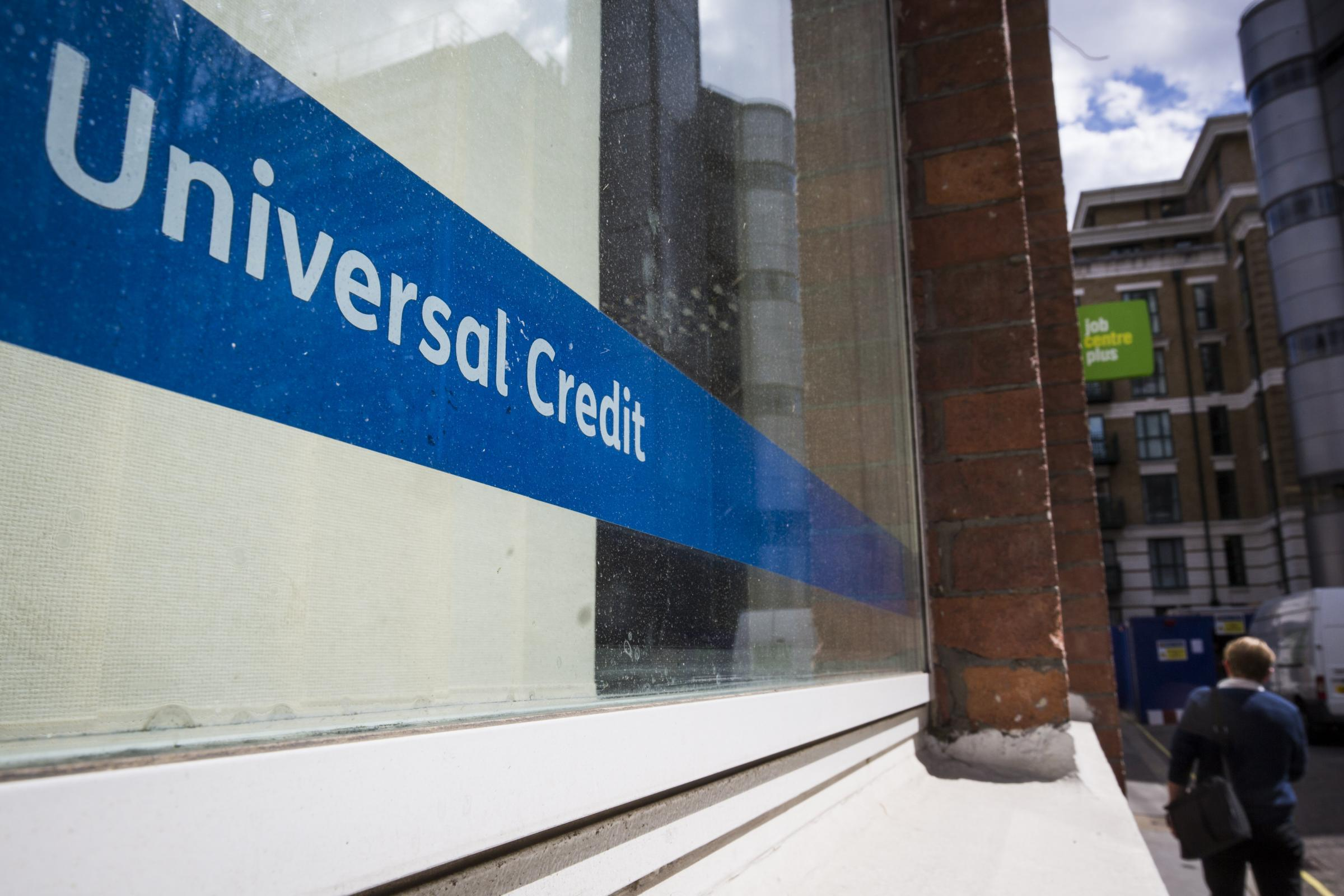 A Universal Credit sign in the window of the Job Centre in Westminster. (Photo by Jack Taylor/Getty Images).