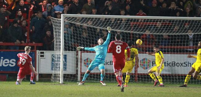 Luke Armstrong (left) seals Oxford United's defeat in stoppage-time at Accrington Stanley  Picture: Richard Parkes