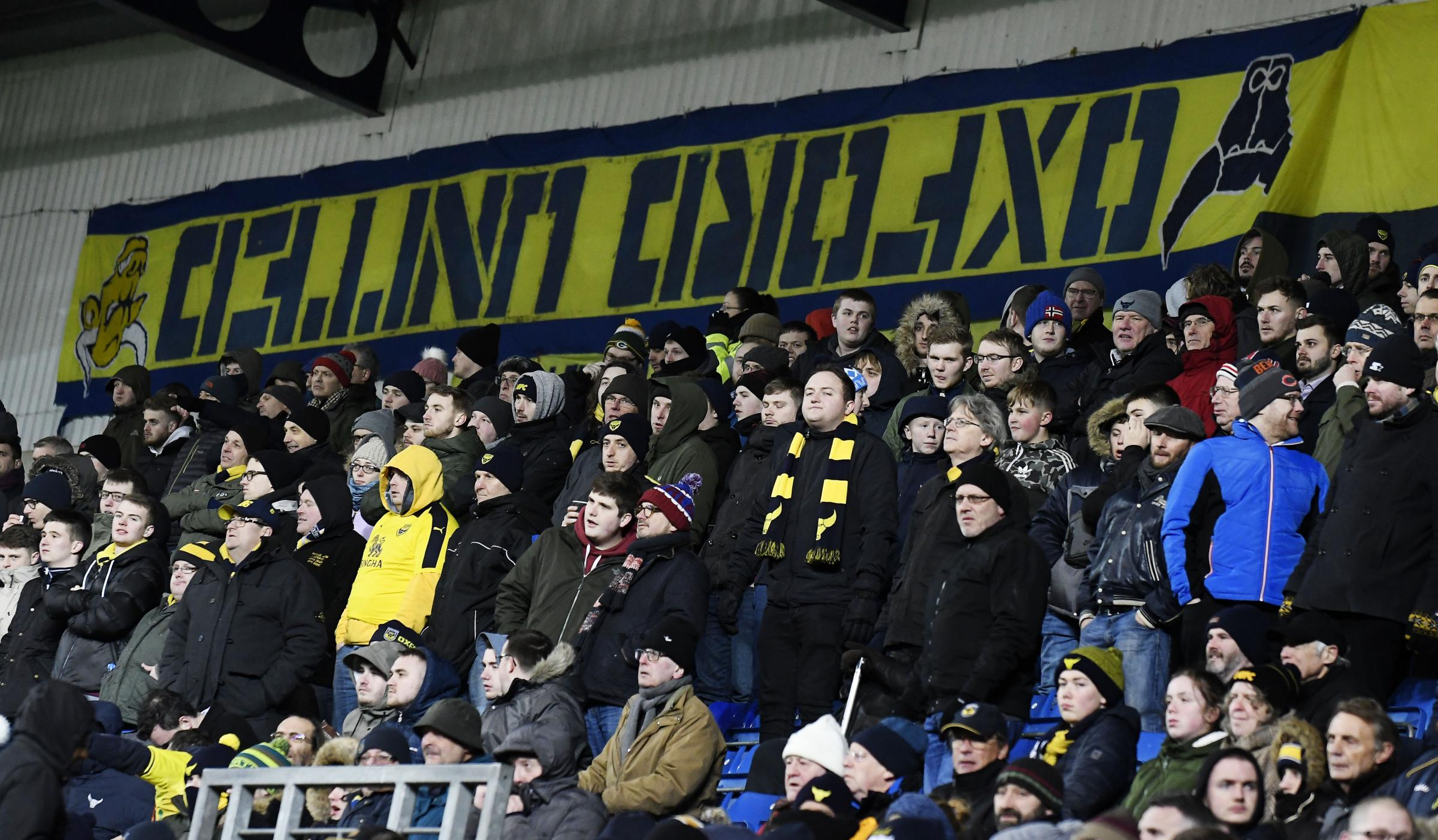 Oxford Ultras with their upside-down flags at the recent home game against Barnsley Picture: David Fleming