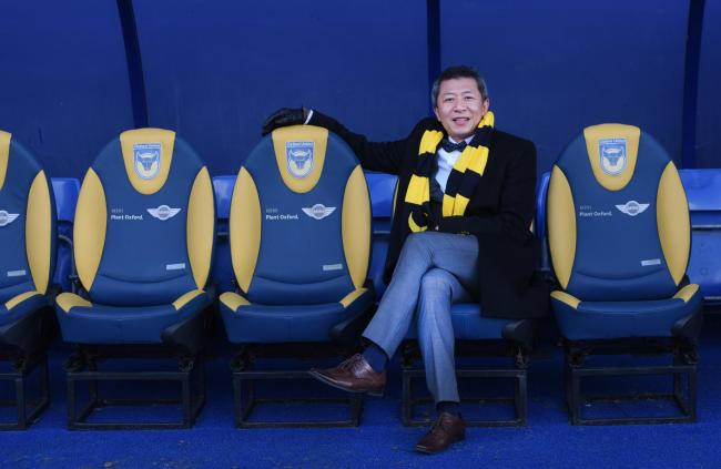 Sumrith 'Tiger' Thanakarnjanasuth poses on the home bench after being unveiled as Oxford United's new chairman    Picture: Richard Cave