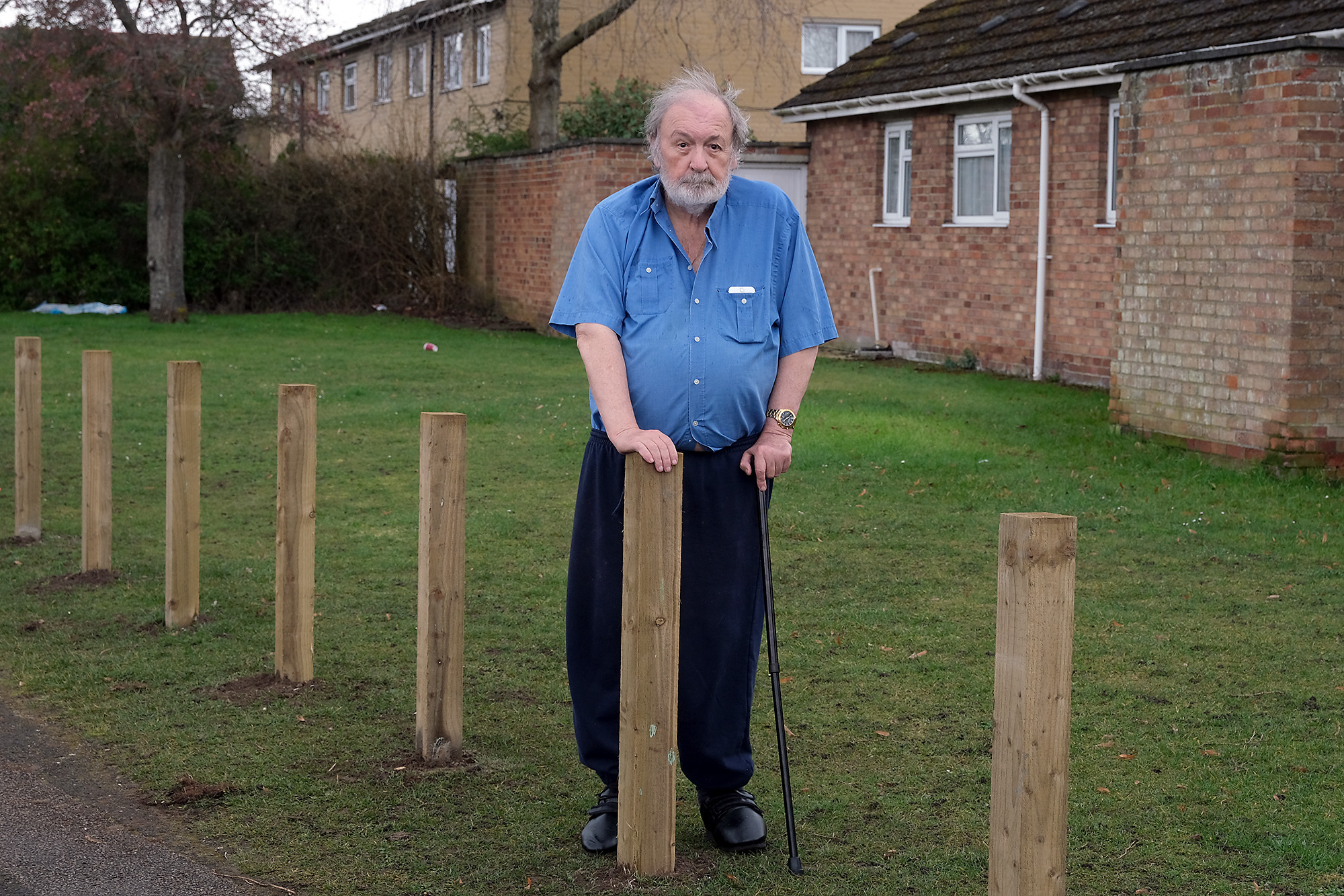 Bollards Stop Parking: 80 year old David Baker outide his home in Abingdon where Sovereign Housing have put bollards on the grass outside his house where he used to park his car.