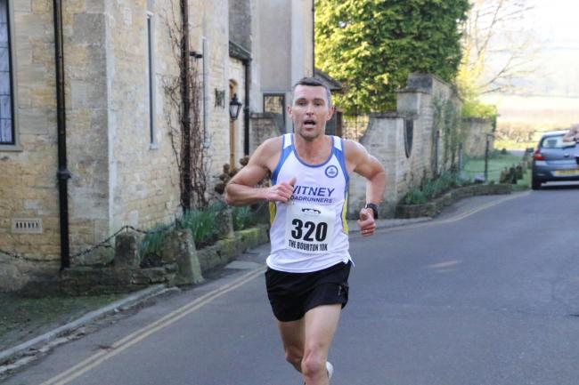 Witney's Tegs Jones in action at the Bourton 10k Picture: Barry Cornelius