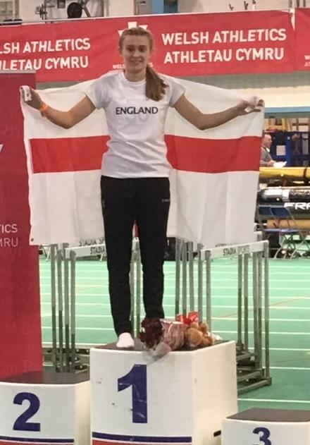 Ella Turner proudly stands on the podium after her victory