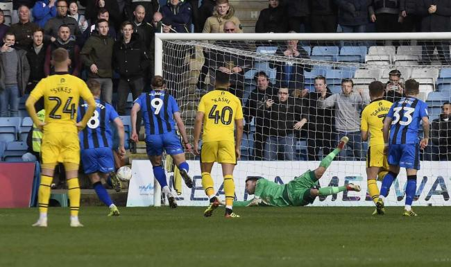 Simon Eastwood keeps out a penalty from Gillingham top scorer Tom Eaves  Picture: David Fleming