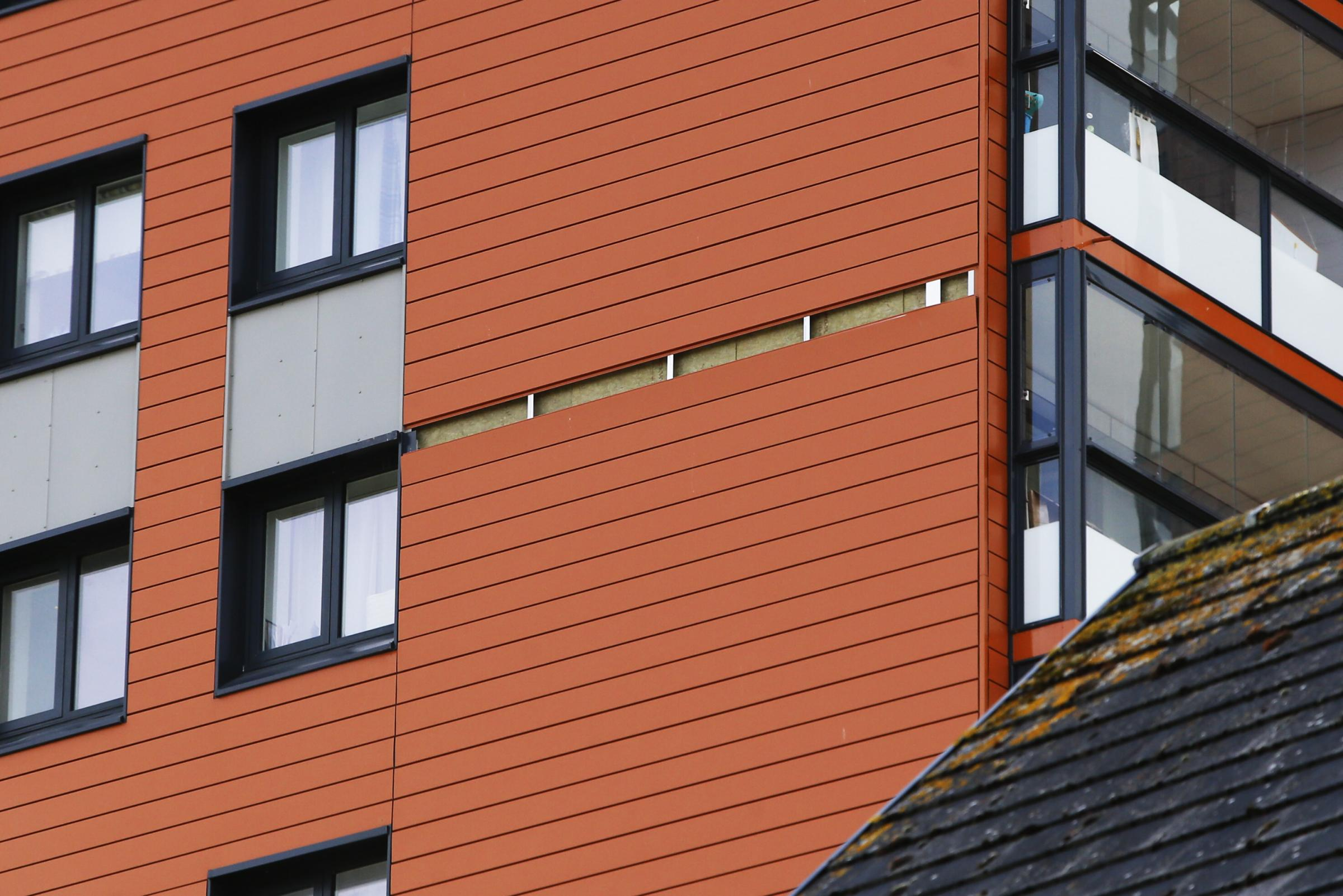 Cladding 'comes off' tower block in high winds