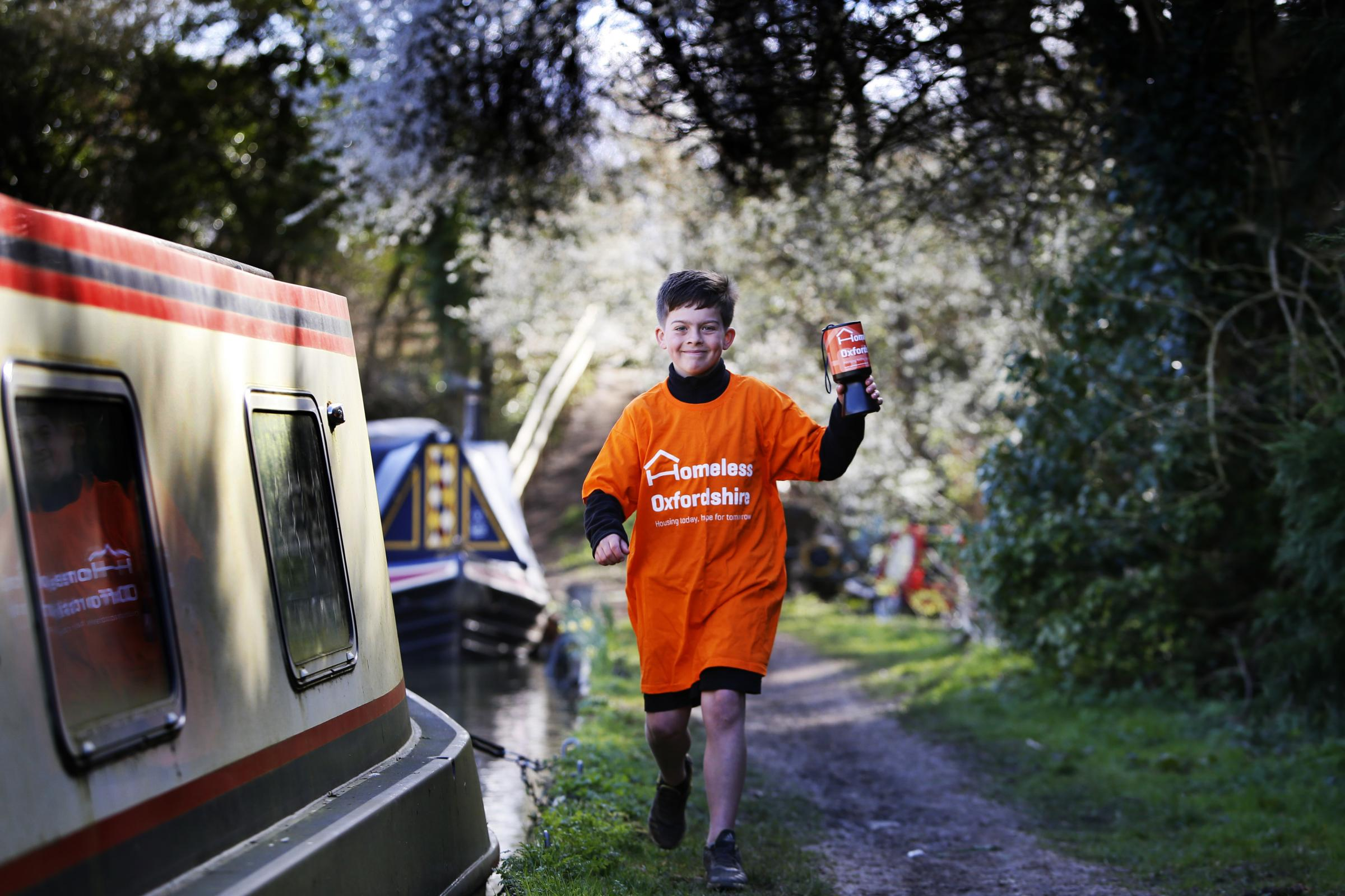 Bobby MacKenzie, eight, is walking seven miles along the Oxford Canal for Homeless Oxfordshire. He wants to raise lots of money to help the homeless. Picture: Ed Nix