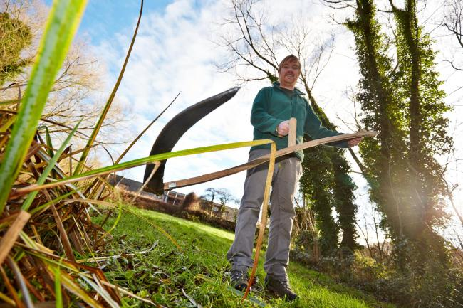 Date: 17/12/2013.Location: Oxford.Catchline: Hedgerows.Length: Lead.Requested by: Oliver Evans.Pic sales ref: OX64210.Photographer : Cliff Hide..Andy Gunn uses a scythe to clear a path at the Rivermead Nature Park in Rose Hill to open up the reserve and m