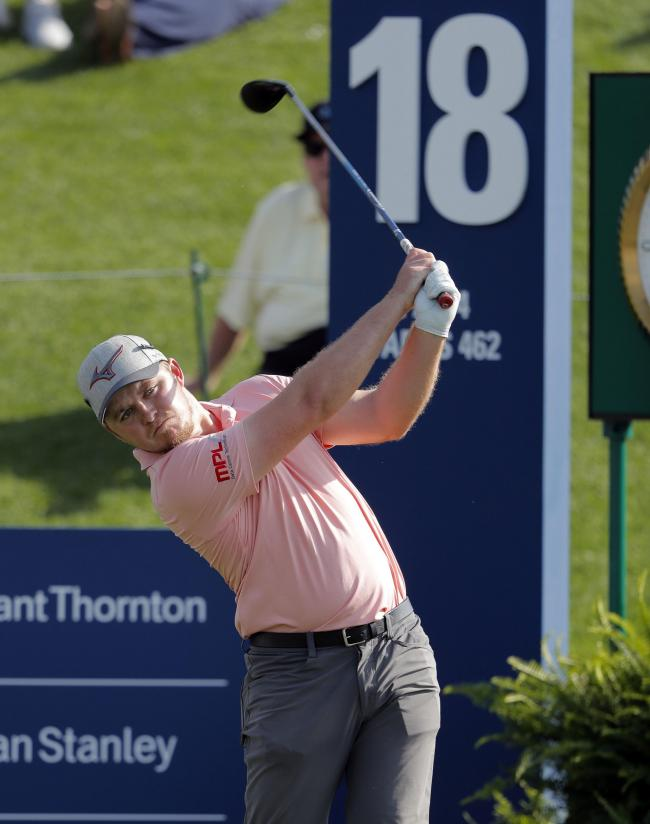 Eddie Pepperell tees off at the 18th during the second round of the Players Championship Picture: AP Photo/Gerald Herbert