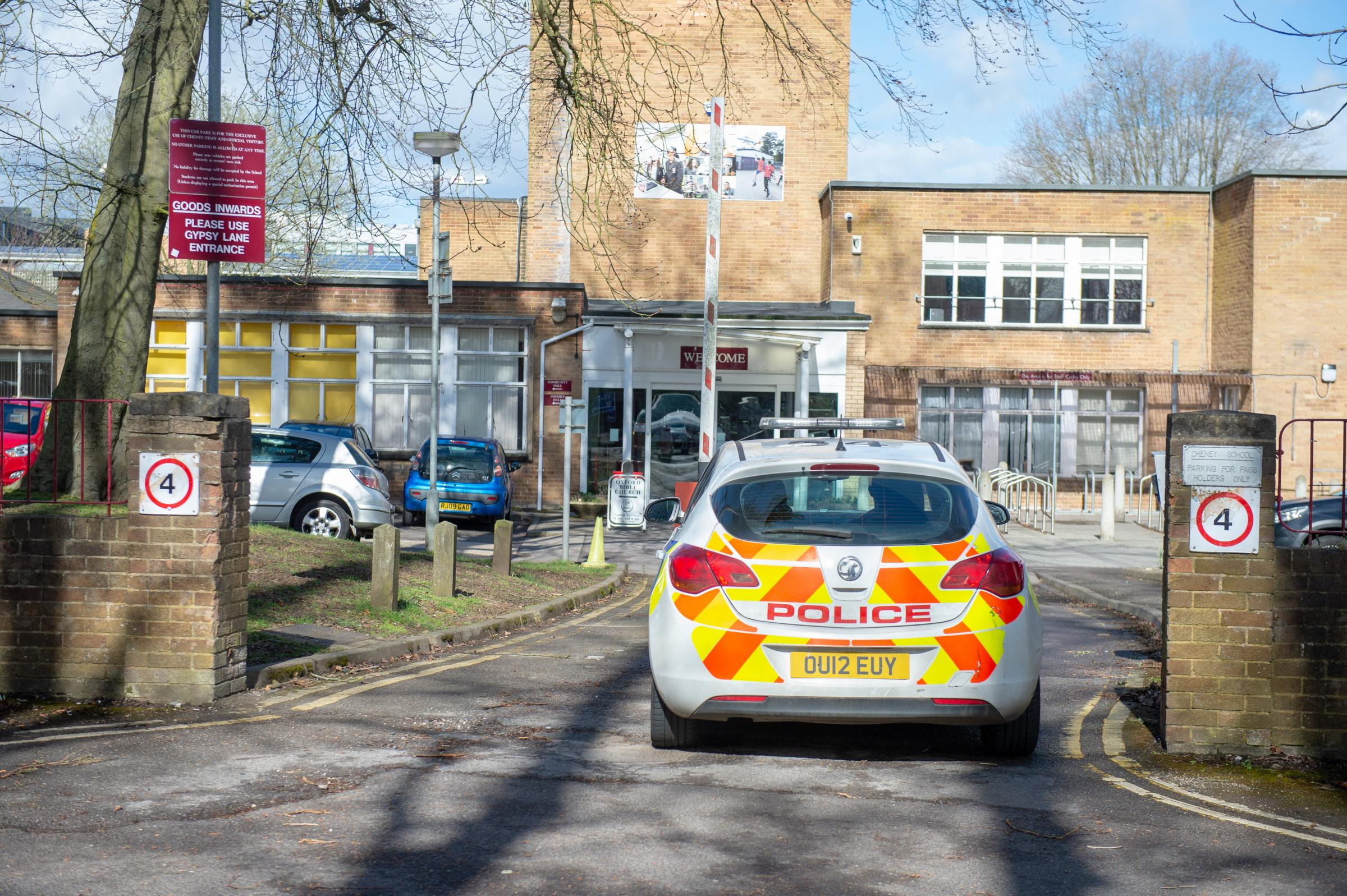 Police at Cheney School on Saturday during the clean-up