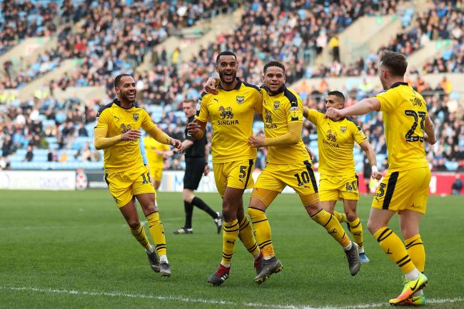 Curtis Nelson (No 5) is congratulated after putting Oxford United ahead at Coventry City  Picture: James Williamson