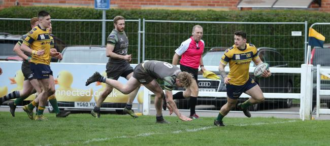 Dan Barnes scores one of his three tries for Henley against Guernsey Picture: Steve Karpa