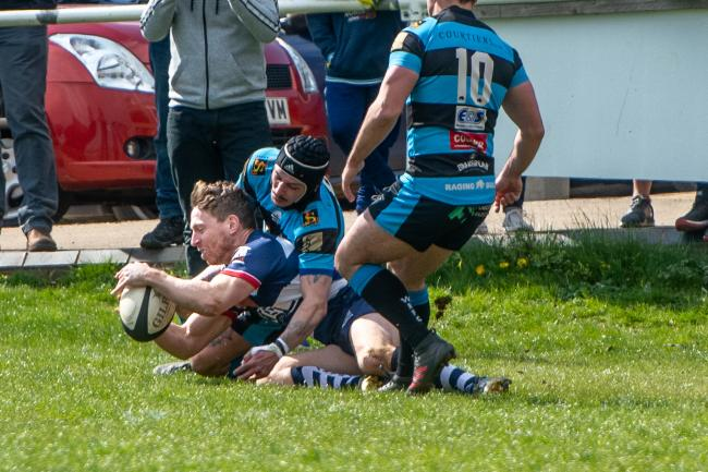 Justin Parker goes over for one of his three tries during Banbury's win over Witney Picture: Richard Cave