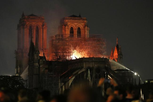Firefighters tackle the blaze at Notre Dame