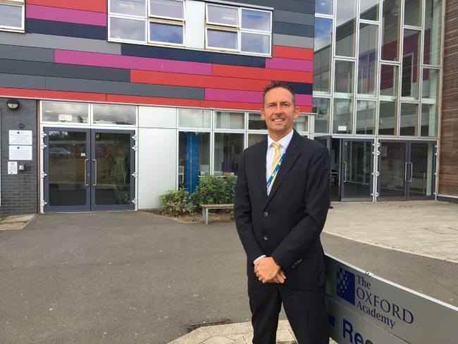 Andy Hardy, headteacher of The Oxford Academy in Littlemore, outside the school