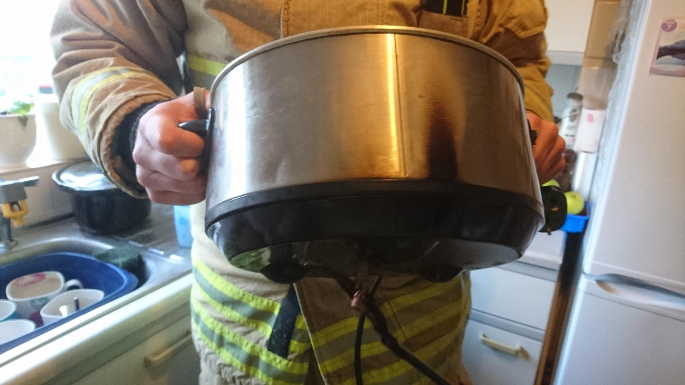 Slow cooker catches fire after being left on top of a hob