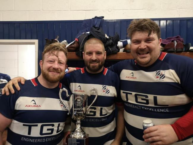 Banbury's Joe Winpenny, Ian Isham and Pete Boulton celebrate winning the Oxfordshire Cup Picture: Alex Inch