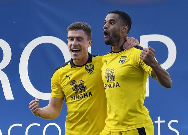 Curtis Nelson (right) celebrates his goal for Oxford United  Picture: David Fleming