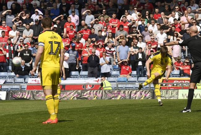 Luke Garbutt hits the free-kick which proved to be the winner for Oxford United against Charlton Athletic  Picture: David Fleming
