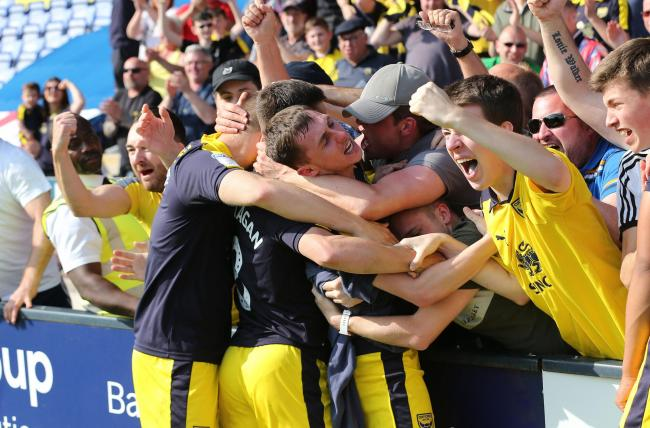 Gavin Whyte celebrates his hat-trick with the Oxford United fans at Shrewsbury Picture: Richard Parkes