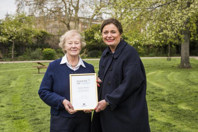Rosanne Bostock (left) receives her Points of Light award. Pic: Keep Britain Tidy