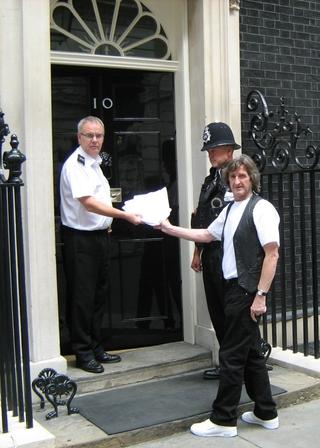 Mick Haines hands the petition in at Number 10