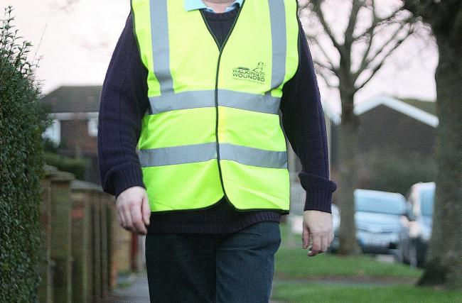 File photo of a man in a high-vis jacket