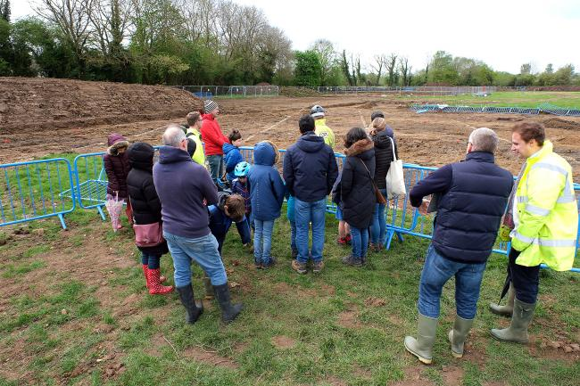 A group of schoolchildren learn about the archaeology investigations on the building site of Oxford's new Swan School in Marston. Picture: Ric Mellis