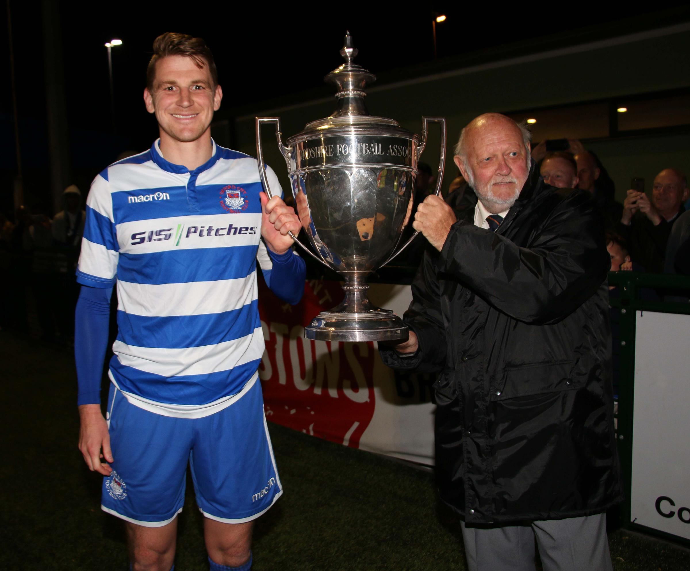 Oxford City captain Joe Oastler is presented with the Oxfordshire Senior Cup Picture: Steve Daniels
