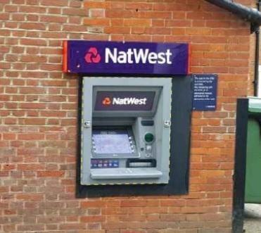 The cashpoint at the Thame NatWest which is being replaced with a sign.