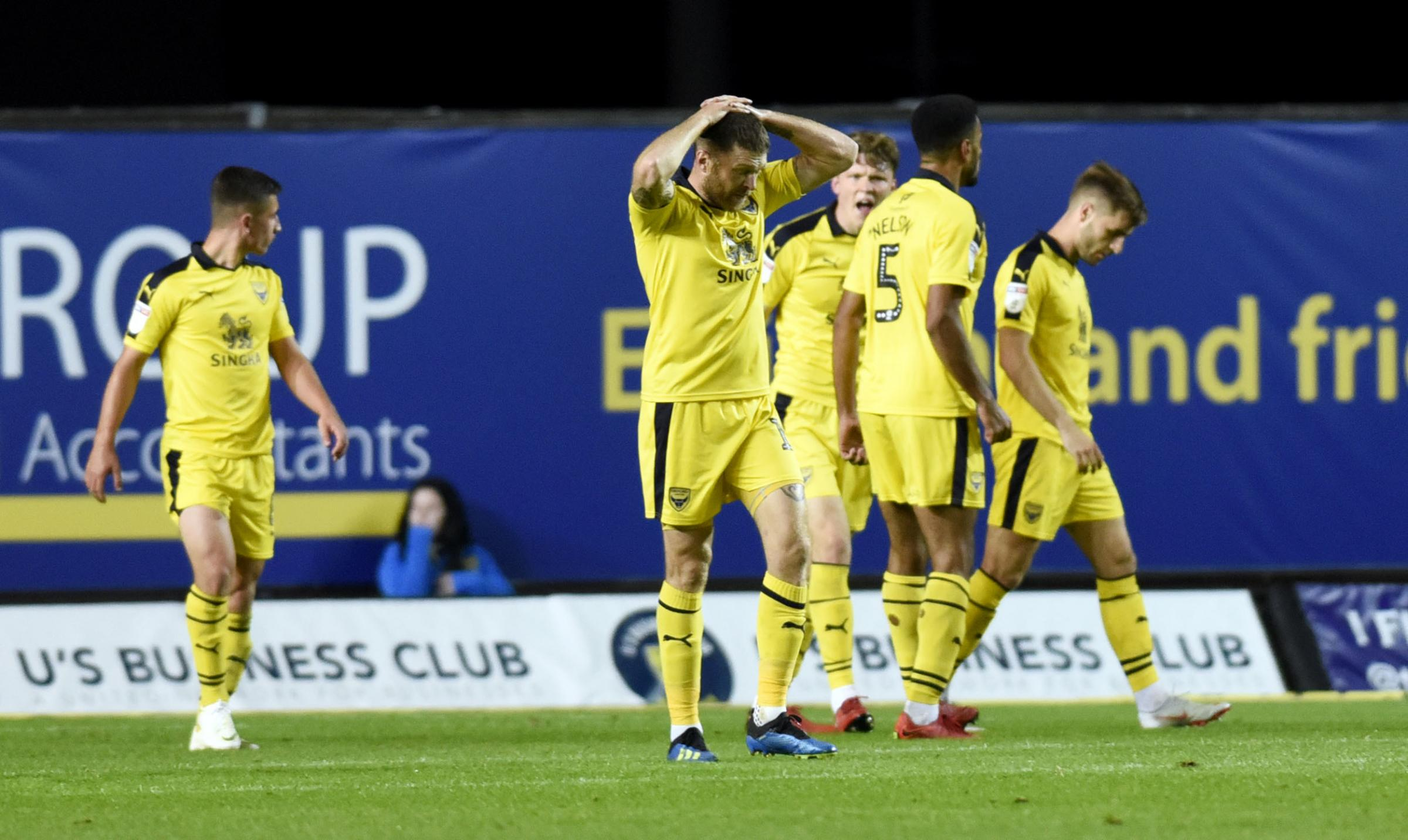 Oxford United players react to their last-gasp defeat against Luton Town in October, which was their eighth defeat in 11 games   Picture: David Fleming