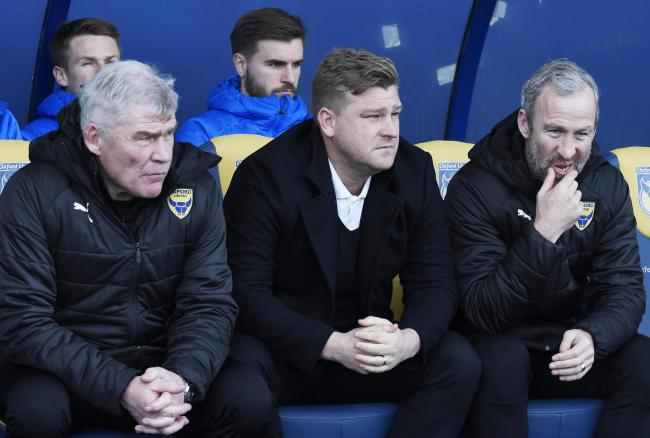 Karl Robinson (centre) and Derek Fazackerley (left) will continue as a pair next season after Shaun Derry's decision to move on  Picture: David Fleming