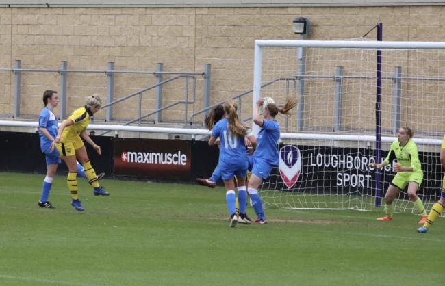 Emily Allen rises to head in Oxford United's equaliser at Loughborough    Picture: Darrell Fisher