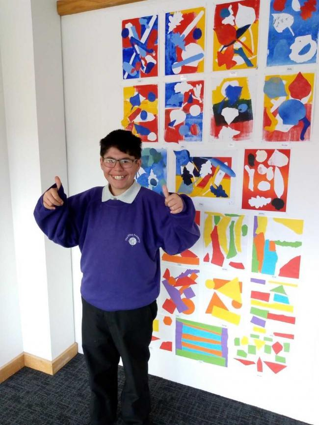 An Iffley Academy pupil standing next to the artwork at St Helen's